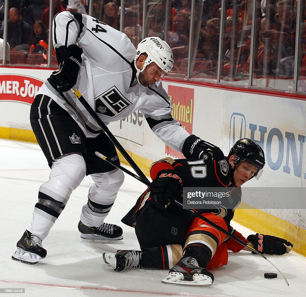 <a gi-track='captionPersonalityLinkClicked' href=/galleries/search?phrase=Corey+Perry&family=editorial&specificpeople=213864 ng-click='$event.stopPropagation()'>Corey Perry</a> #10 of the Anaheim Ducks battles for the puck against <a gi-track='captionPersonalityLinkClicked' href=/galleries/search?phrase=Robyn+Regehr&family=editorial&specificpeople=171828 ng-click='$event.stopPropagation()'>Robyn Regehr</a> #44 of the Los Angeles Kings on April 7, 2013 at Honda Center in Anaheim, California.