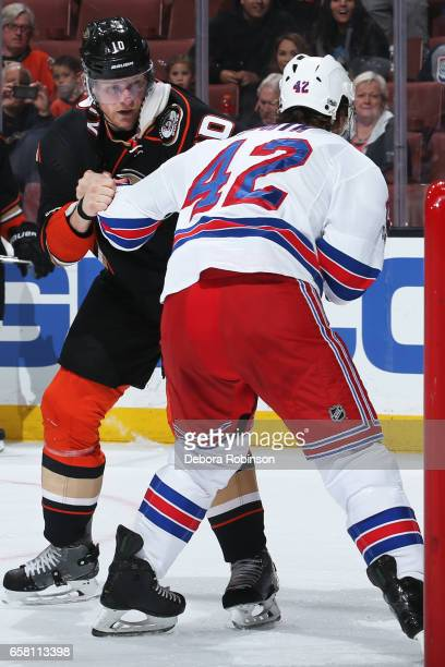 Corey Perry of the Anaheim Ducks battles in a fight against Brendan Smith of the New York Rangers during the game on March 26 2017 at Honda Center in...