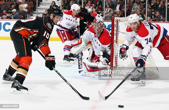Corey Perry of the Anaheim Ducks battles John Carlson of the Washington Capitals to get to the puck with goalie Justin Peters in net on February 15...