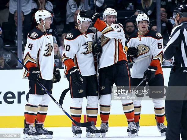 Corey Perry of the Anaheim Ducks celebrates his game winning goal in overtime with Nick Richie Cam Fowler and Rickard Rakell against the Los Angeles...