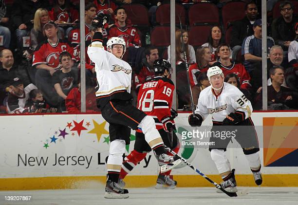 Corey Perry of the Anaheim Ducks celebrates his goal at 1608 of the second period against the New Jersey Devils as Jason Blake skates in to join him...