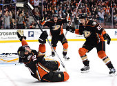 Corey Perry of the Anaheim Ducks celebrates his goal with Shawn Horcoff and Jakob Silfverberg to tie the game 22 with the Florida Panthers with five...