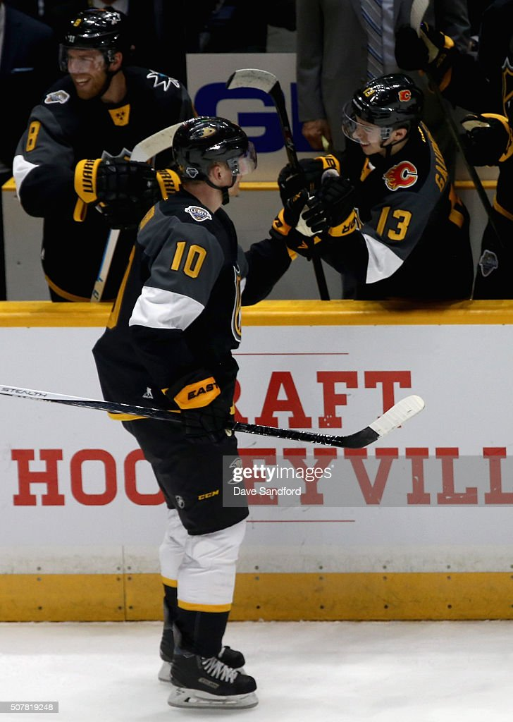 <a gi-track='captionPersonalityLinkClicked' href=/galleries/search?phrase=Corey+Perry&family=editorial&specificpeople=213864 ng-click='$event.stopPropagation()'>Corey Perry</a> #10 of the Anaheim Ducks celebrates his goal with teammate <a gi-track='captionPersonalityLinkClicked' href=/galleries/search?phrase=Johnny+Gaudreau&family=editorial&specificpeople=8953159 ng-click='$event.stopPropagation()'>Johnny Gaudreau</a> #13 of the Calgary Flames during the 2016 Honda NHL All-Star Final Game between the Atlantic Division All-Stars of the Eastern Conference and the Pacific Division All-Stars of the Western Conference at Bridgestone Arena on January 31, 2016 in Nashville, Tennessee. The Pacific Division All-Stars of the Western Conference defeated the Atlantic Division All-Stars of the Eastern Conference 1-0.