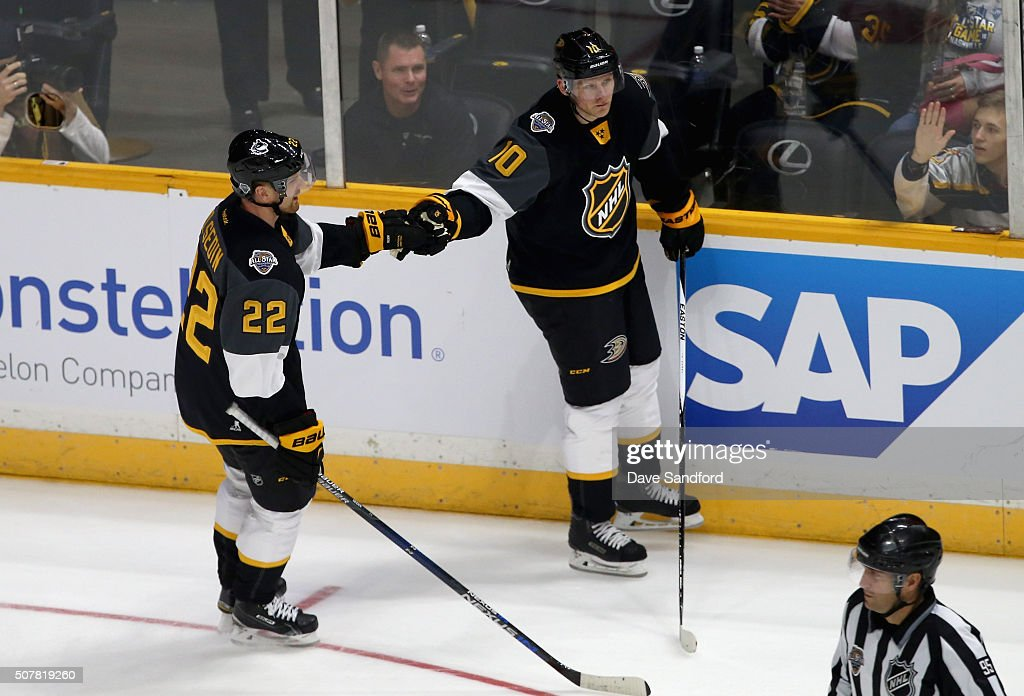 Corey Perry of the Anaheim Ducks celebrates his goal with teammate Daniel Sedin of the Vancouver Canucks during the 2016 Honda NHL AllStar Final Game...