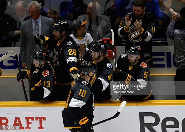 Corey Perry of the Anaheim Ducks celebrates his goal with teammates on the bench during the 2016 Honda NHL AllStar Final Game between the Atlantic...