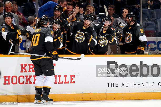 Corey Perry of the Anaheim Ducks celebrates with teammates after scoring a goal during the 2016 Honda NHL AllStar Final Game between the Eastern...