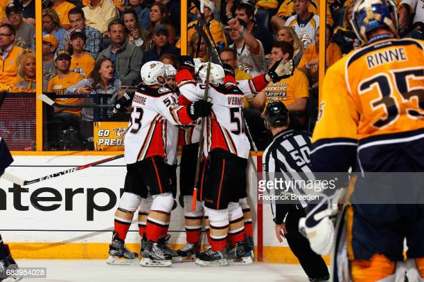 Corey Perry of the Anaheim Ducks celebrates with teammates after scoring a goal against Pekka Rinne of the Nashville Predators during the second...
