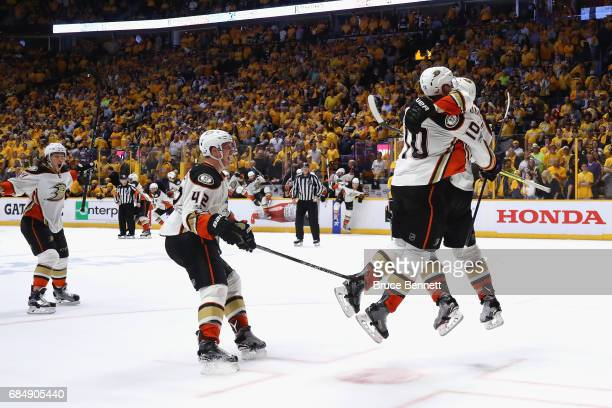 Corey Perry of the Anaheim Ducks celebrates with teammates after scoring a goal during the overtime period to defeat the Nashville Predators 32 in...