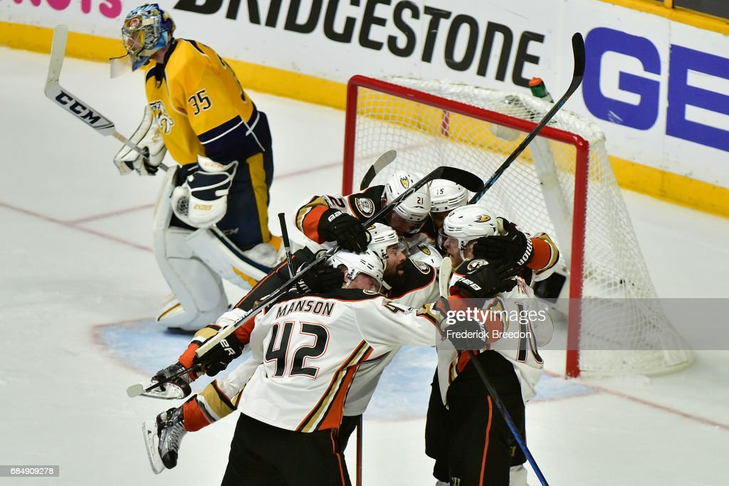 Corey Perry #10 of the Anaheim Ducks celebrates with teammates after scoring a goal during the overtime period to defeat the Nashville Predators 3-2 in Game Four of the Western Conference Final during the 2017 Stanley Cup Playoffs at Bridgestone Arena on May 18, 2017 in Nashville, Tennessee.