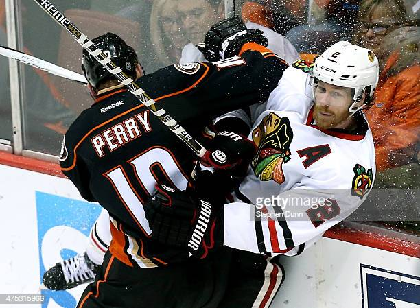 Corey Perry of the Anaheim Ducks checks Duncan Keith of the Chicago Blackhawks in the first period in Game Seven of the Western Conference Finals...