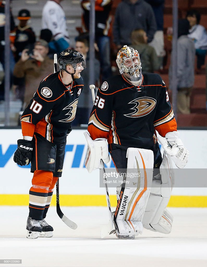 Corey Perry #10 of the Anaheim Ducks congratulates John Gibson #36 of the Anaheim Ducks after a game against the Vancouver Canucks at Honda Center on November 30, 2015 in Anaheim, California.