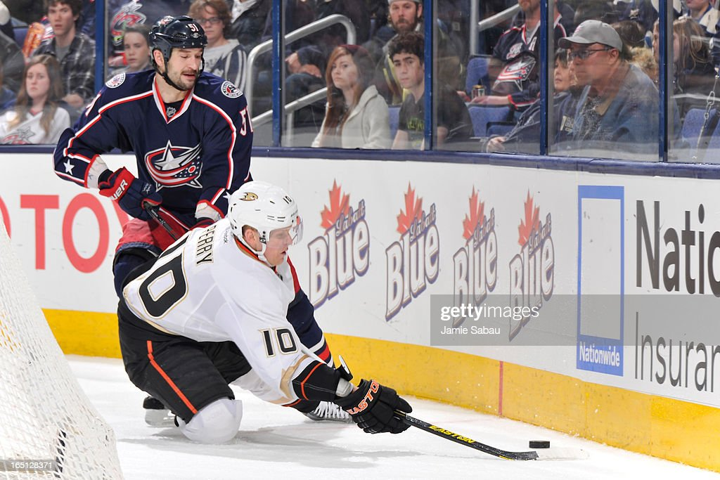 <a gi-track='captionPersonalityLinkClicked' href=/galleries/search?phrase=Corey+Perry&family=editorial&specificpeople=213864 ng-click='$event.stopPropagation()'>Corey Perry</a> #10 of the Anaheim Ducks continues to play the puck after being knocked down by <a gi-track='captionPersonalityLinkClicked' href=/galleries/search?phrase=Fedor+Tyutin&family=editorial&specificpeople=215245 ng-click='$event.stopPropagation()'>Fedor Tyutin</a> #51 of the Columbus Blue Jackets during the second period on March 31, 2013 at Nationwide Arena in Columbus, Ohio.