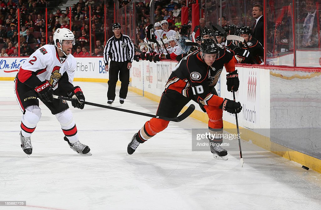 <a gi-track='captionPersonalityLinkClicked' href=/galleries/search?phrase=Corey+Perry&family=editorial&specificpeople=213864 ng-click='$event.stopPropagation()'>Corey Perry</a> #10 of the Anaheim Ducks controls the puck along the boards against <a gi-track='captionPersonalityLinkClicked' href=/galleries/search?phrase=Jared+Cowen&family=editorial&specificpeople=4594191 ng-click='$event.stopPropagation()'>Jared Cowen</a> #2 of the Ottawa Senators at Canadian Tire Centre on October 25, 2013 in Ottawa, Ontario, Canada.