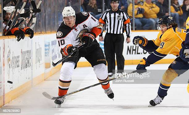 Corey Perry of the Anaheim Ducks dumps the puck in the zone against the Nashville Predators during an NHL game at Bridgestone Arena on February 5...