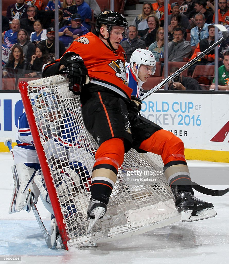Corey Perry #10 of the Anaheim Ducks falls back onto the net as Antti Raanta #32 of the New York Rangers looks on from inside the net during the game on March 16, 2016 at Honda Center in Anaheim, California.