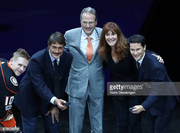 Corey Perry of the Anaheim Ducks former Ducks player Teemu Selanne Ducks owners Henry and Susan Samueli and former Ducks player Paul Kariya pose for...