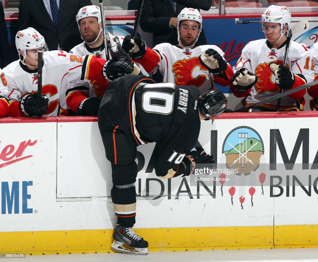 <a gi-track='captionPersonalityLinkClicked' href=/galleries/search?phrase=Corey+Perry&family=editorial&specificpeople=213864 ng-click='$event.stopPropagation()'>Corey Perry</a> #10 of the Anaheim Ducks gets his leg stuck in the opponents bench during the game against the Calgary Flames on October 16, 2013 at Honda Center in Anaheim, California.
