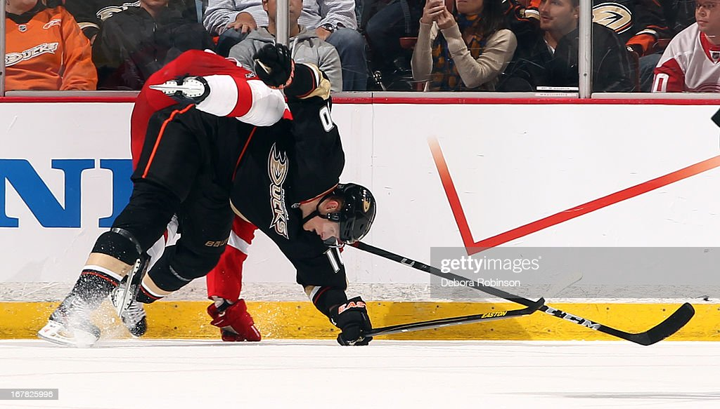 Corey Perry #10 of the Anaheim Ducks gets tangled up with a Detroit Red Wings player in Game One of the Western Conference Quarterfinals during the 2013 NHL Stanley Cup Playoffs at Honda Center on April 30, 2013 in Anaheim, California.