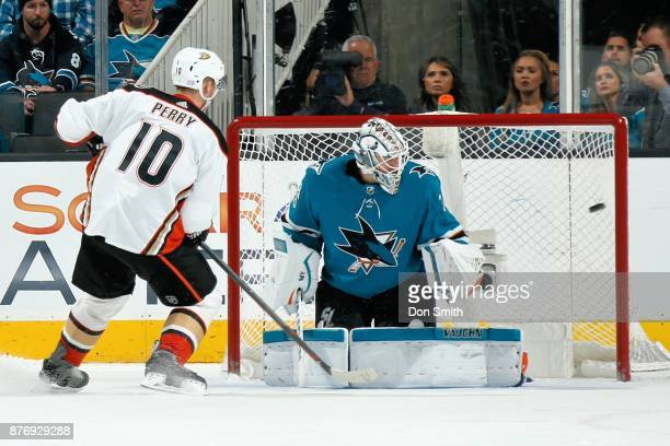 Corey Perry of the Anaheim Ducks gets the puck by Martin Jones of the San Jose Sharks for a shootout goal at SAP Center on November 20 2017 in San...