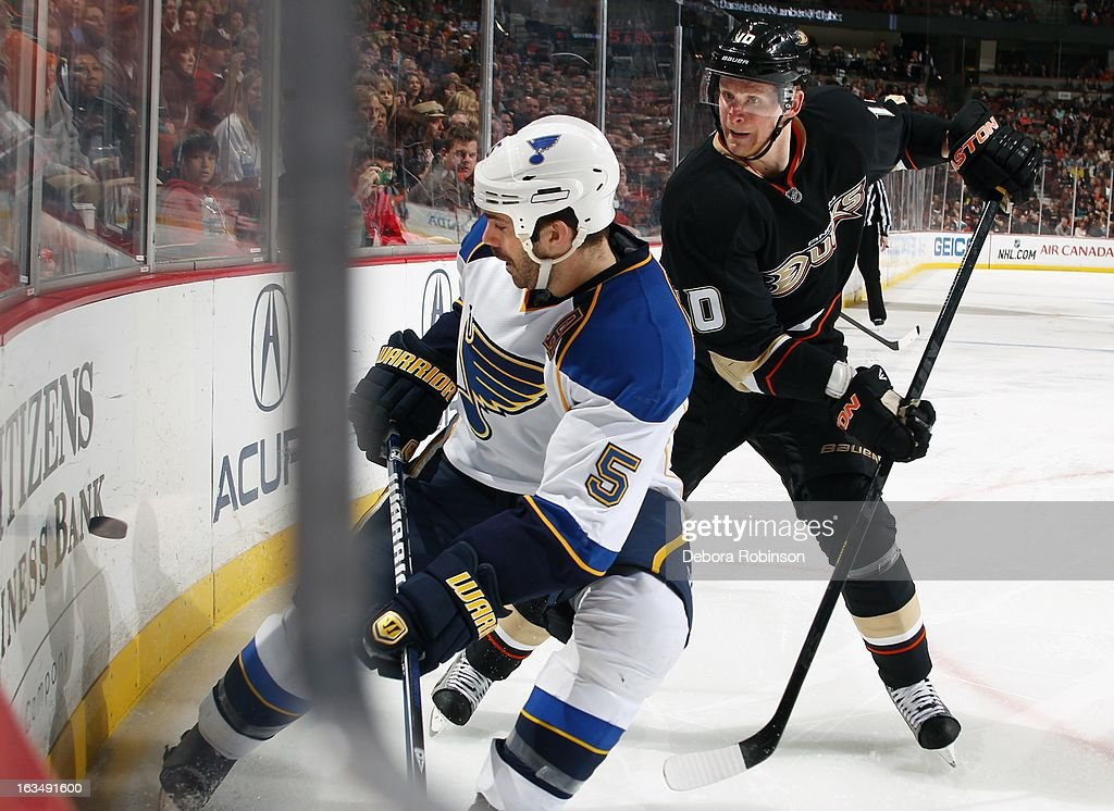 Corey Perry #10 of the Anaheim Ducks goes after the puck against Barret Jackman #5 of the St. Louis Blues on March 10, 2013 at Honda Center in Anaheim, California.