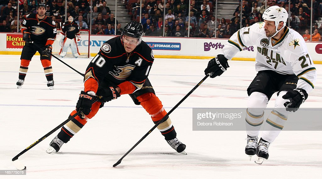 <a gi-track='captionPersonalityLinkClicked' href=/galleries/search?phrase=Corey+Perry&family=editorial&specificpeople=213864 ng-click='$event.stopPropagation()'>Corey Perry</a> #10 of the Anaheim Ducks handles the puck against <a gi-track='captionPersonalityLinkClicked' href=/galleries/search?phrase=Aaron+Rome&family=editorial&specificpeople=2139287 ng-click='$event.stopPropagation()'>Aaron Rome</a> #27 of the Dallas Stars on April 5, 2013 at Honda Center in Anaheim, California.