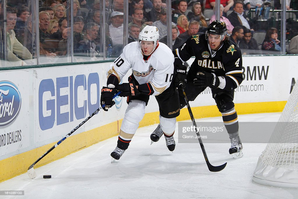 <a gi-track='captionPersonalityLinkClicked' href=/galleries/search?phrase=Corey+Perry&family=editorial&specificpeople=213864 ng-click='$event.stopPropagation()'>Corey Perry</a> #10 of the Anaheim Ducks handles the puck against Brenden Dillon #4 of the Dallas Stars at the American Airlines Center on February 8, 2013 in Dallas, Texas.