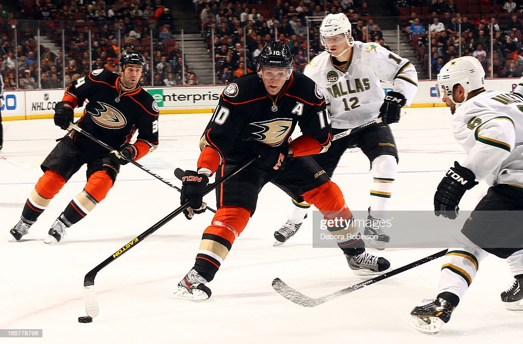 <a gi-track='captionPersonalityLinkClicked' href=/galleries/search?phrase=Corey+Perry&family=editorial&specificpeople=213864 ng-click='$event.stopPropagation()'>Corey Perry</a> #10 of the Anaheim Ducks handles the puck against <a gi-track='captionPersonalityLinkClicked' href=/galleries/search?phrase=Trevor+Daley&family=editorial&specificpeople=213975 ng-click='$event.stopPropagation()'>Trevor Daley</a> #6 and Alex Chiasson #12 of the Dallas Stars on April 5, 2013 at Honda Center in Anaheim, California.