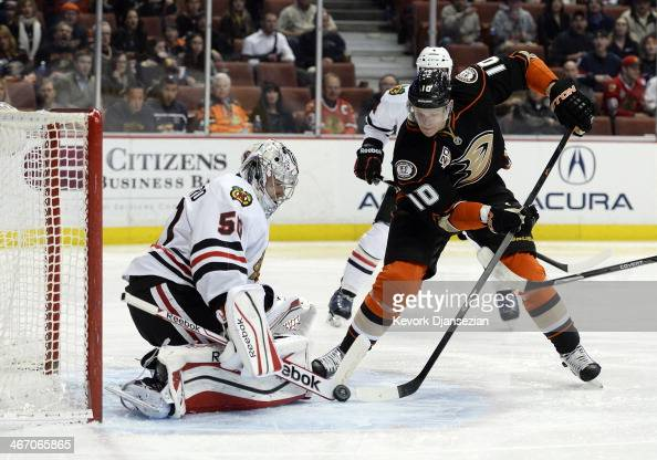 Corey Perry of the Anaheim Ducks has his shot on goal blocked by goalkeeper Corey Crawford of the Chicago Blackhawks at Honda Center on February 05...