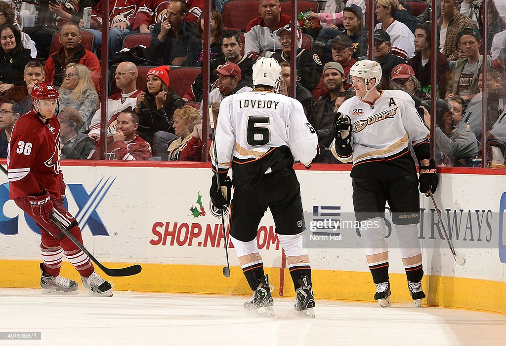 <a gi-track='captionPersonalityLinkClicked' href=/galleries/search?phrase=Corey+Perry&family=editorial&specificpeople=213864 ng-click='$event.stopPropagation()'>Corey Perry</a> #10 of the Anaheim Ducks is congratulated by teammate <a gi-track='captionPersonalityLinkClicked' href=/galleries/search?phrase=Ben+Lovejoy&family=editorial&specificpeople=4509565 ng-click='$event.stopPropagation()'>Ben Lovejoy</a> #6 after his goal against the Phoenix Coyotes during the second period at Jobing.com Arena on November 23, 2013 in Glendale, Arizona.