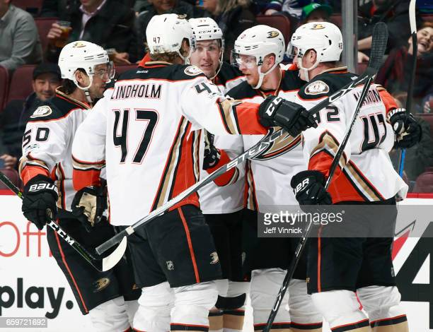 Corey Perry of the Anaheim Ducks is congratulated by teammates after scoring during their NHL game against the Vancouver Canucks at Rogers Arena...
