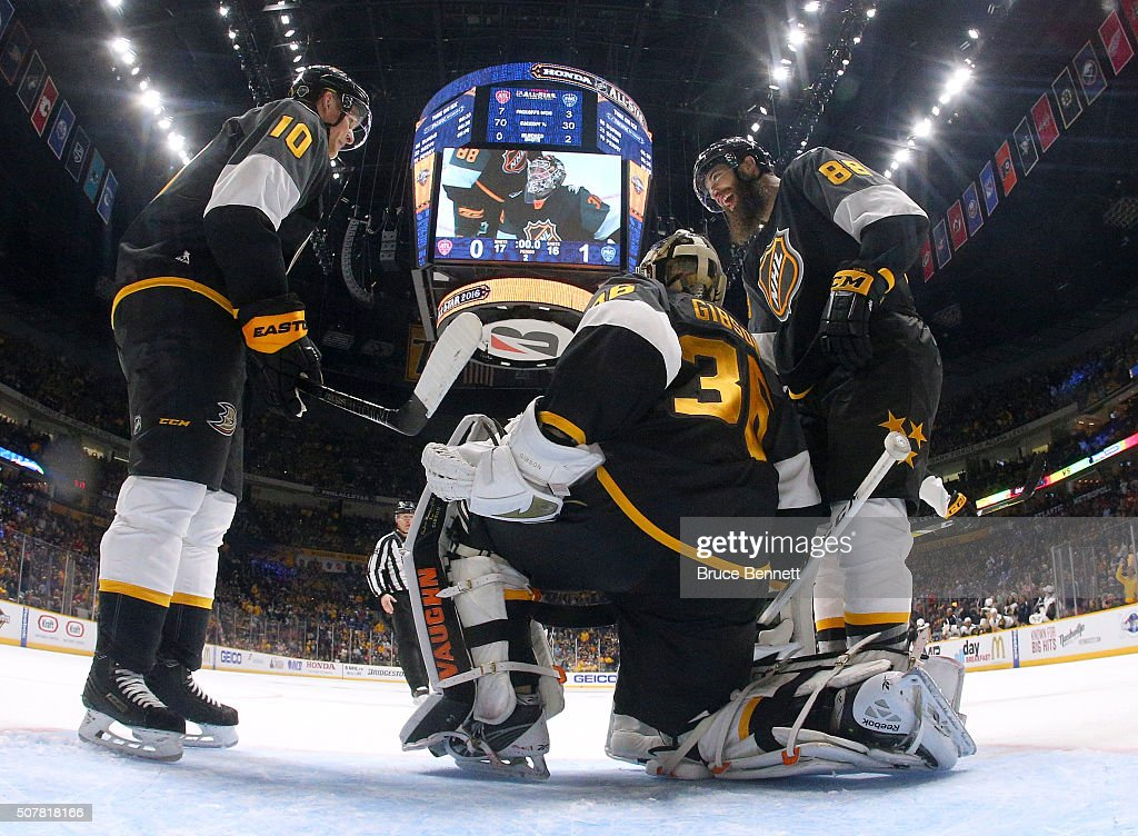 Corey Perry of the Anaheim Ducks John Gibson of the Anaheim Ducks and Brent Burns of the San Jose Sharks celebrate defeating the Atlantic Division...