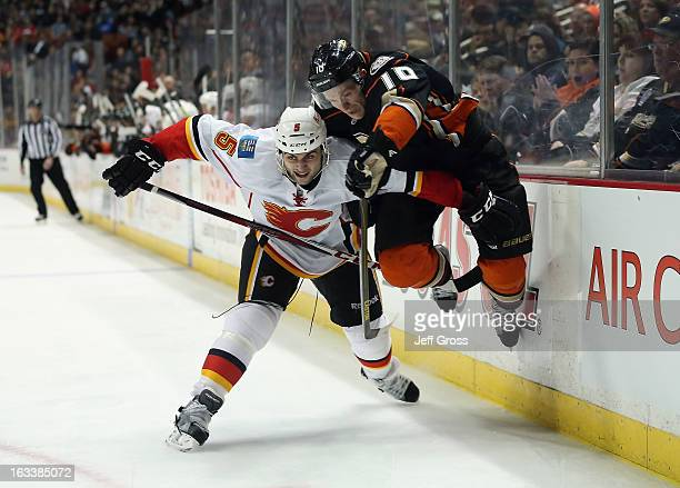 Corey Perry of the Anaheim Ducks jumps over the check of Mark Giordano of the Calgary Flames in the third period at Honda Center on March 8 2013 in...