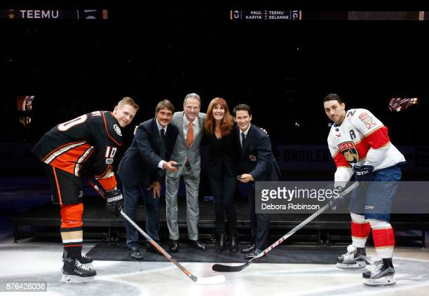 Corey Perry of the Anaheim Ducks left and Vincent Trocheck of the Florida Panthers pose with Hockey Hall of Famers and former Anaheim Ducks Teemu...