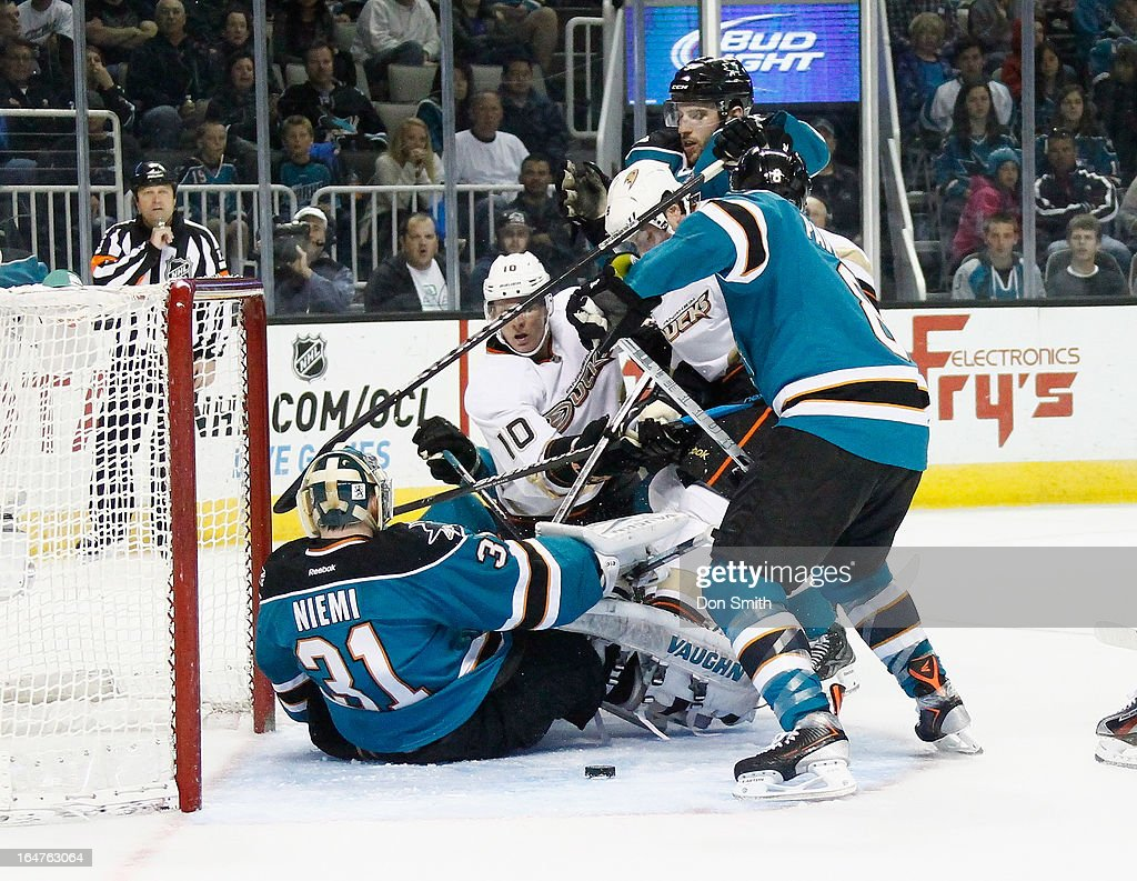 <a gi-track='captionPersonalityLinkClicked' href=/galleries/search?phrase=Corey+Perry&family=editorial&specificpeople=213864 ng-click='$event.stopPropagation()'>Corey Perry</a> #10 of the Anaheim Ducks looks for a rebound against <a gi-track='captionPersonalityLinkClicked' href=/galleries/search?phrase=Antti+Niemi&family=editorial&specificpeople=213913 ng-click='$event.stopPropagation()'>Antti Niemi</a> #31 and <a gi-track='captionPersonalityLinkClicked' href=/galleries/search?phrase=Joe+Pavelski&family=editorial&specificpeople=687042 ng-click='$event.stopPropagation()'>Joe Pavelski</a> #8 of the San Jose Sharks during an NHL game on March 27, 2013 at HP Pavilion in San Jose, California.