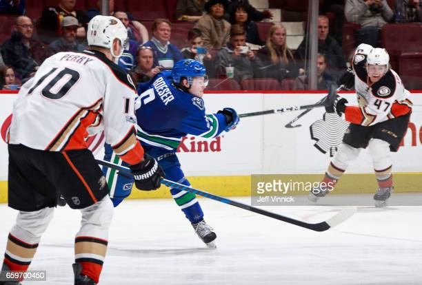 Corey Perry of the Anaheim Ducks looks on as Brock Boeser of the Vancouver Canucks takes a shot and scores during their NHL game at Rogers Arena...