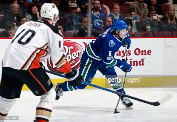 Corey Perry of the Anaheim Ducks looks on as Brock Boeser of the Vancouver Canucks takes a shot to score during their NHL game at Rogers Arena March...