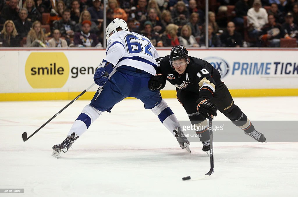 <a gi-track='captionPersonalityLinkClicked' href=/galleries/search?phrase=Corey+Perry&family=editorial&specificpeople=213864 ng-click='$event.stopPropagation()'>Corey Perry</a> #10 of the Anaheim Ducks lunges for the puck around Andrej Sustr #62 of the Tampa Bay Lightning in the third period at Honda Center on November 22, 2013 in Anaheim, California. The Ducks defeated the Lightning 1-0 in overtime.