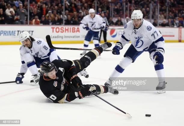 Corey Perry of the Anaheim Ducks lunges for the puck while falling to the ice between Mark Barberio and Victor Hedman of the Tampa Bay Lightning at...