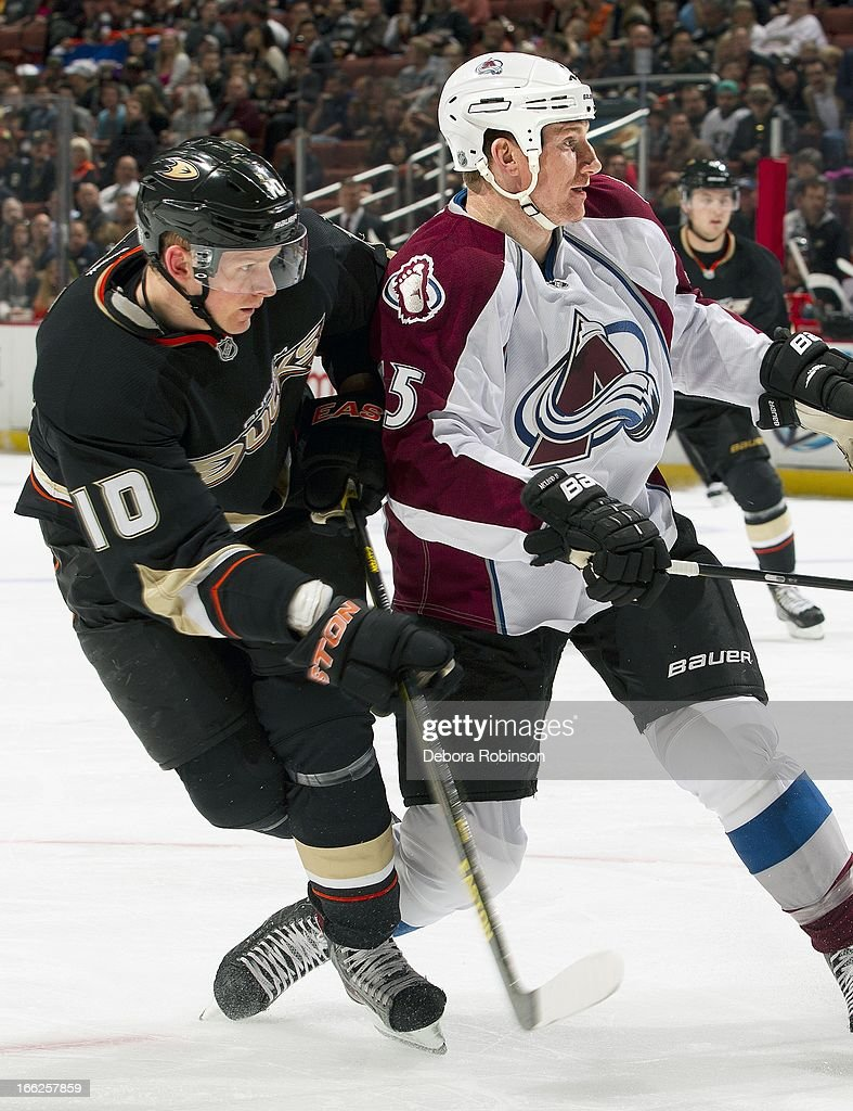 Corey Perry #10 of the Anaheim Ducks mixes it up with Cody McLeod #55 of the Colorado Avalanche April 10, 2013 at Honda Center in Anaheim, California.