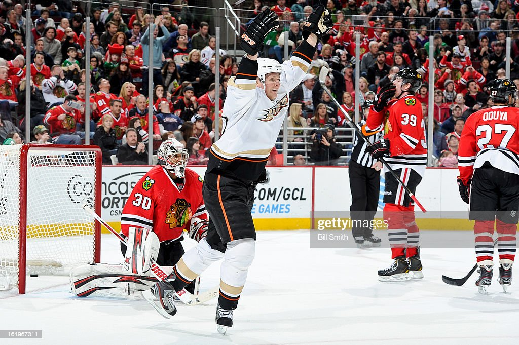 <a gi-track='captionPersonalityLinkClicked' href=/galleries/search?phrase=Corey+Perry&family=editorial&specificpeople=213864 ng-click='$event.stopPropagation()'>Corey Perry</a> #10 of the Anaheim Ducks reacts in front of goalie <a gi-track='captionPersonalityLinkClicked' href=/galleries/search?phrase=Ray+Emery&family=editorial&specificpeople=218109 ng-click='$event.stopPropagation()'>Ray Emery</a> #30 of the Chicago Blackhawks after the Ducks scored in the third during the NHL game on March 29, 2013 at the United Center in Chicago, Illinois.