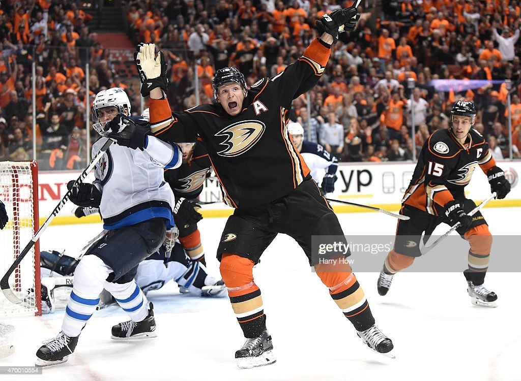 <a gi-track='captionPersonalityLinkClicked' href=/galleries/search?phrase=Corey+Perry&family=editorial&specificpeople=213864 ng-click='$event.stopPropagation()'>Corey Perry</a> #10 of the Anaheim Ducks reacts to his goal in front of <a gi-track='captionPersonalityLinkClicked' href=/galleries/search?phrase=Blake+Wheeler&family=editorial&specificpeople=716703 ng-click='$event.stopPropagation()'>Blake Wheeler</a> #26 of the Winnipeg Jets during the third period in Game One of the Western Conference Quarterfinals during the 2015 NHL Stanley Cup Playoffs at Honda Center on April 16, 2015 in Anaheim, California. Video replay was used to determine the goal.
