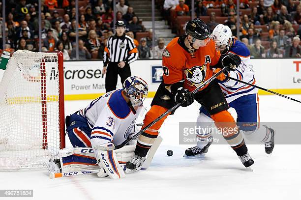 Corey Perry of the Anaheim Ducks scores as Anders Nilsson of the Edmonton Oilers and Darnell Nurse of the Edmonton Oilers defend during the first...