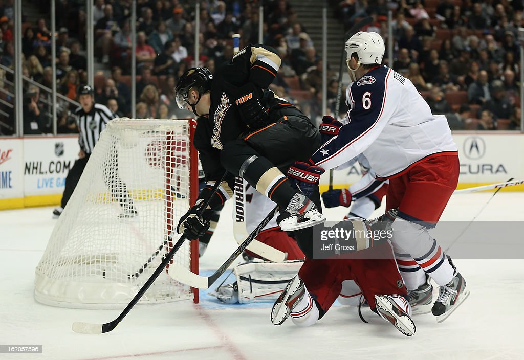 <a gi-track='captionPersonalityLinkClicked' href=/galleries/search?phrase=Corey+Perry&family=editorial&specificpeople=213864 ng-click='$event.stopPropagation()'>Corey Perry</a> #10 of the Anaheim Ducks scores as he's checked by <a gi-track='captionPersonalityLinkClicked' href=/galleries/search?phrase=Nikita+Nikitin&family=editorial&specificpeople=722107 ng-click='$event.stopPropagation()'>Nikita Nikitin</a> #6 of the Columbus Blue Jackets in the third period at Honda Center on February 18, 2013 in Anaheim, California. The Ducks defeated the Blue Jackets 3-2.