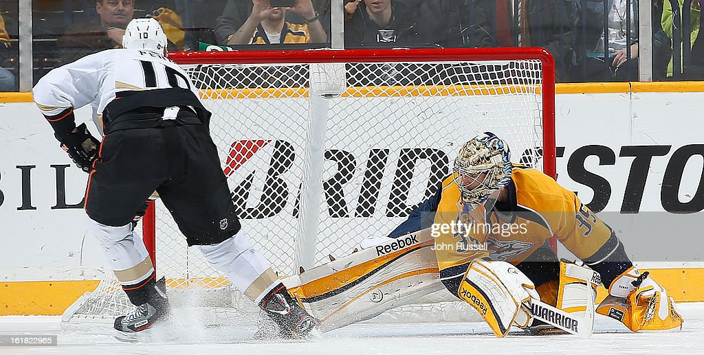 <a gi-track='captionPersonalityLinkClicked' href=/galleries/search?phrase=Corey+Perry&family=editorial&specificpeople=213864 ng-click='$event.stopPropagation()'>Corey Perry</a> #10 of the Anaheim Ducks scores the game winner in a shootout against <a gi-track='captionPersonalityLinkClicked' href=/galleries/search?phrase=Pekka+Rinne&family=editorial&specificpeople=2118342 ng-click='$event.stopPropagation()'>Pekka Rinne</a> #35 of the Nashville Predators during an NHL game at the Bridgestone Arena on February 16, 2013 in Nashville, Tennessee.