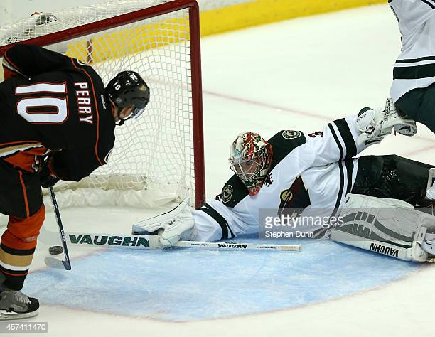 Corey Perry of the Anaheim Ducks scores the game winning goal in the third period past goalie Darcy Kuemper of the Minnesota Wild at Honda Center on...