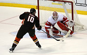 Corey Perry of the Anaheim Ducks shoots and scores in the shootout against goalie Jimmy Howard of the Detroit Red Wings at Honda Center on February...