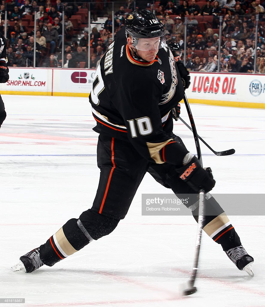 <a gi-track='captionPersonalityLinkClicked' href=/galleries/search?phrase=Corey+Perry&family=editorial&specificpeople=213864 ng-click='$event.stopPropagation()'>Corey Perry</a> #10 of the Anaheim Ducks shoots the puck during the game against the Tampa Bay Lightning on November 22, 2013 at Honda Center in Anaheim, California.