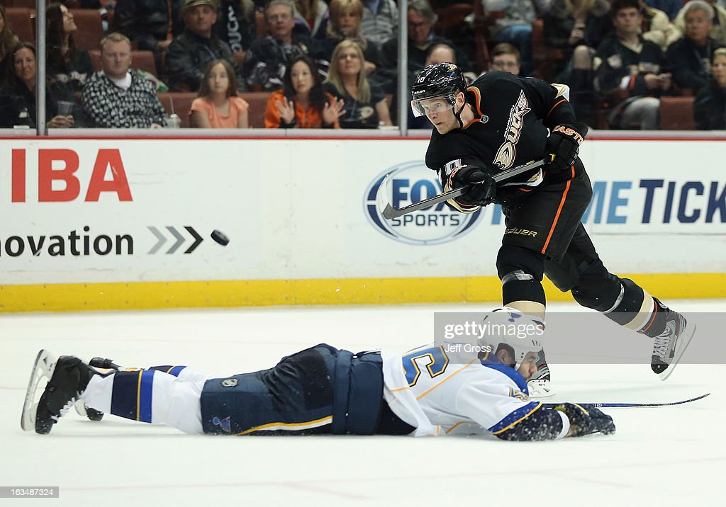 Corey Perry #10 of the Anaheim Ducks shoots the puck over Roman Polak #46 of the St. Louis Blues in the third period at Honda Center on March 10, 2013 in Anaheim, California. The Ducks defeated the Blues 4-2.