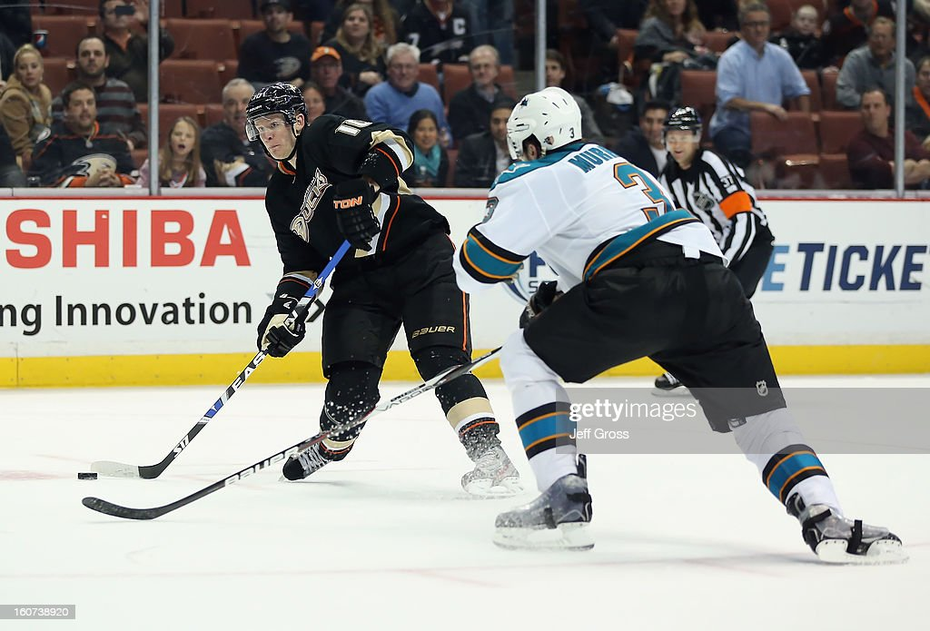 Corey Perry #10 of the Anaheim Ducks shoots the puck past Douglas Murray #3 of the San Jose Sharks in the third period at Honda Center on February 4, 2013 in Anaheim, California. The Ducks defeated the Sharks 2-1.