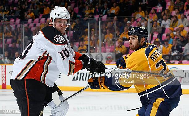 Corey Perry of the Anaheim Ducks skates against Eric Nystrom of the Nashville Predators during an NHL game at Bridgestone Arena on October 22 2015 in...